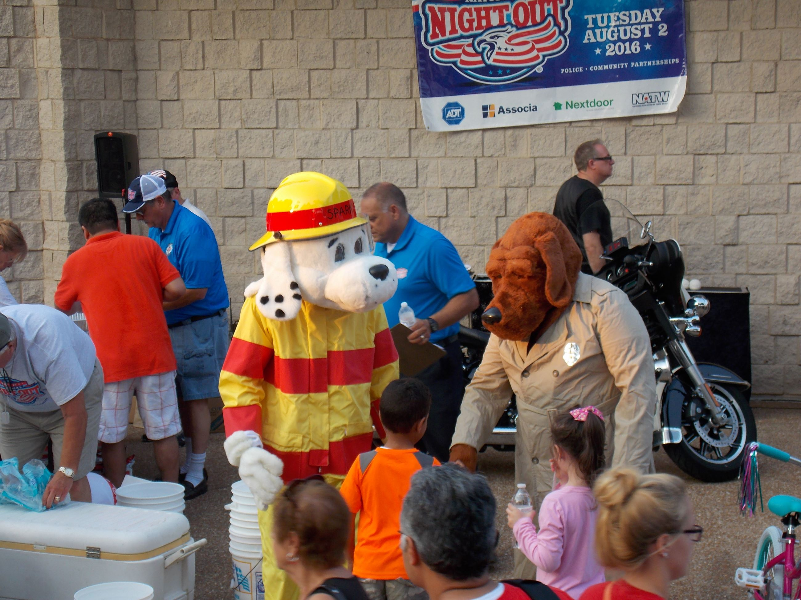 Sparky and McGruff with Children at National Night Out
